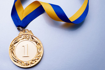 Gold medal on a blue background