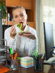 Female worker having vegetables mix