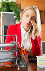 Tired girl in office