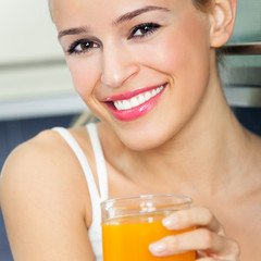 Cheerful woman with orange juice
