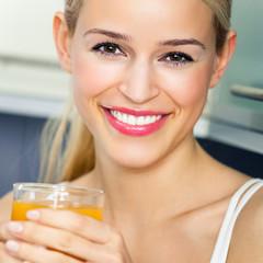 Cheerful woman with orange juice