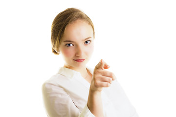 Young blonde businesswoman pointing.