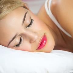 Sleeping woman at bedroom