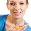 Woman with assorted pills and capsules
