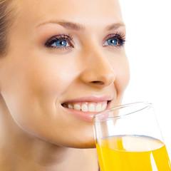 Woman drinking orange juice, over white