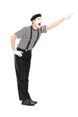 Mime artist pointing up with his hand