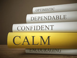 book title of calm isolated on a wooden table poster