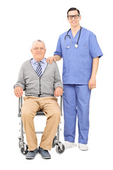 Male nurse and a senior in wheelchair posing