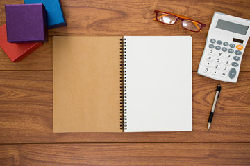 Notebook on wood background