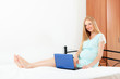 pregnant woman in nightdress  with  laptop