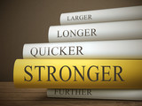 book title of stronger isolated on a wooden table poster