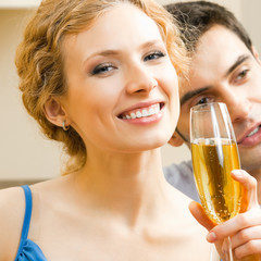 Cheerful couple celebrating with champagne