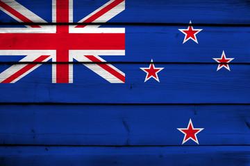 New Zealand Flag on wood background