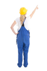 back view of woman in builder uniform pointing at something isol