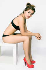 young girl with red shoes in lingerie