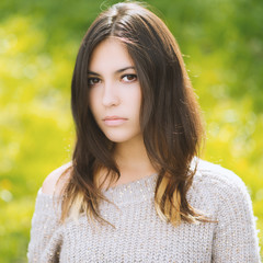 Portrait of young beautiful woman in sweater. Color toned.