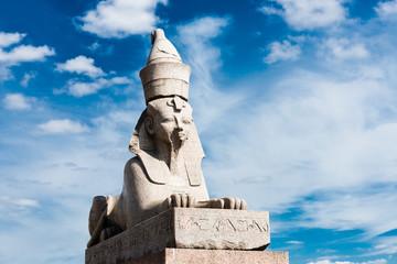 sphinx over blue sky on Universitetskaya embankment of Neva rive
