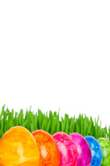 Rainbow colored Easter Eggs grass