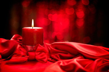 Valentine's Day. Valentine red candle on red silk