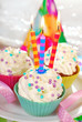 birthday cupcakes with three candles