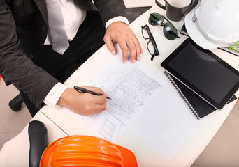 top view of architect working table with drawing perspective bui