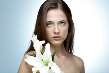 Portrait of attractive young woman with flower