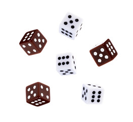 White and colored dice through the Air Isolated on White