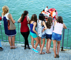 Group of girls, rescue boat