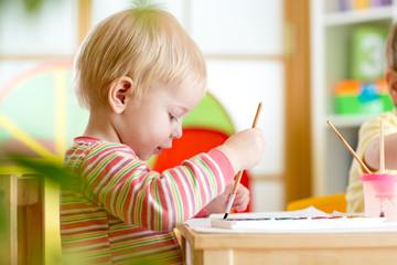 kid painting at home or nursery