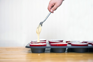 Filling cupcakes with batter