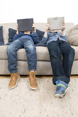 Boys playing games on a Tablet