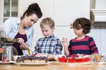 Family Preparing Cupcake