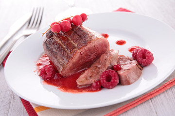 duck breast cooked with raspberry sauce