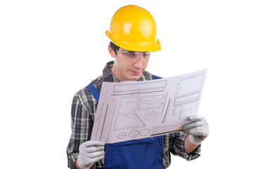 young worker reads a plan