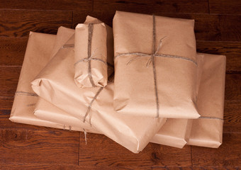 Vintage gift package on wooden background.