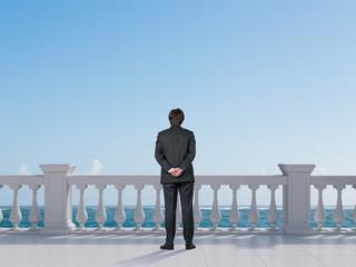 businessman looking to ocean