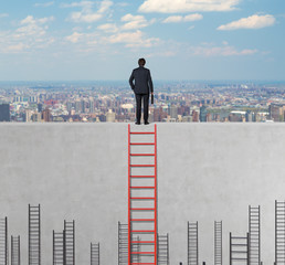 businessman standing on wall