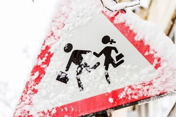 Traffic sign frozen after a snowstorm