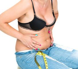 Plump woman pinching her fat tummy