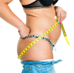 Overweight woman measuring her body