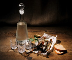 Three glass for vodka with dried capelin and bread