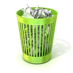 Green trash bin, full of crumpled paper. Isolated on white