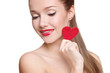 woman with bright makeup and red heart in hand