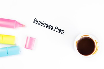 business plan words near highlighters and cup of coffee