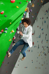 woman on artificial climbing wall