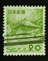Postage stamp  image of an old Japanese house