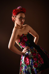 Fashion portrait of a redhead woman posing as Frida Kahlo