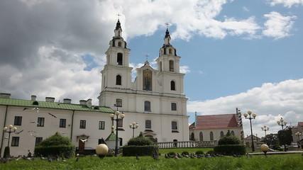 A flock of doves flying near an Orthodox church. Belarus Minsk