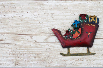 Christmas Background with a Santa Sleigh on Grunge Textured Wood