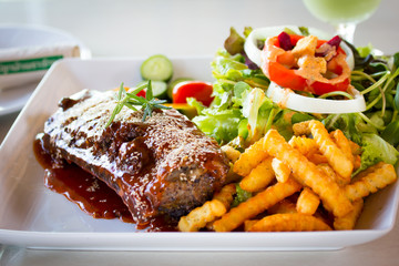BBQ Ribs - Marinated pork ribs with salad, french fries and barb